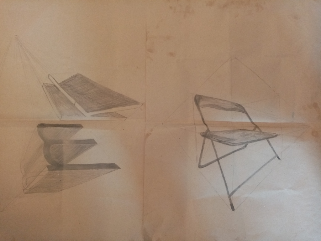 "Drawing of a chair on a right and letters ""m"" and ""k"" on a left in pencil"