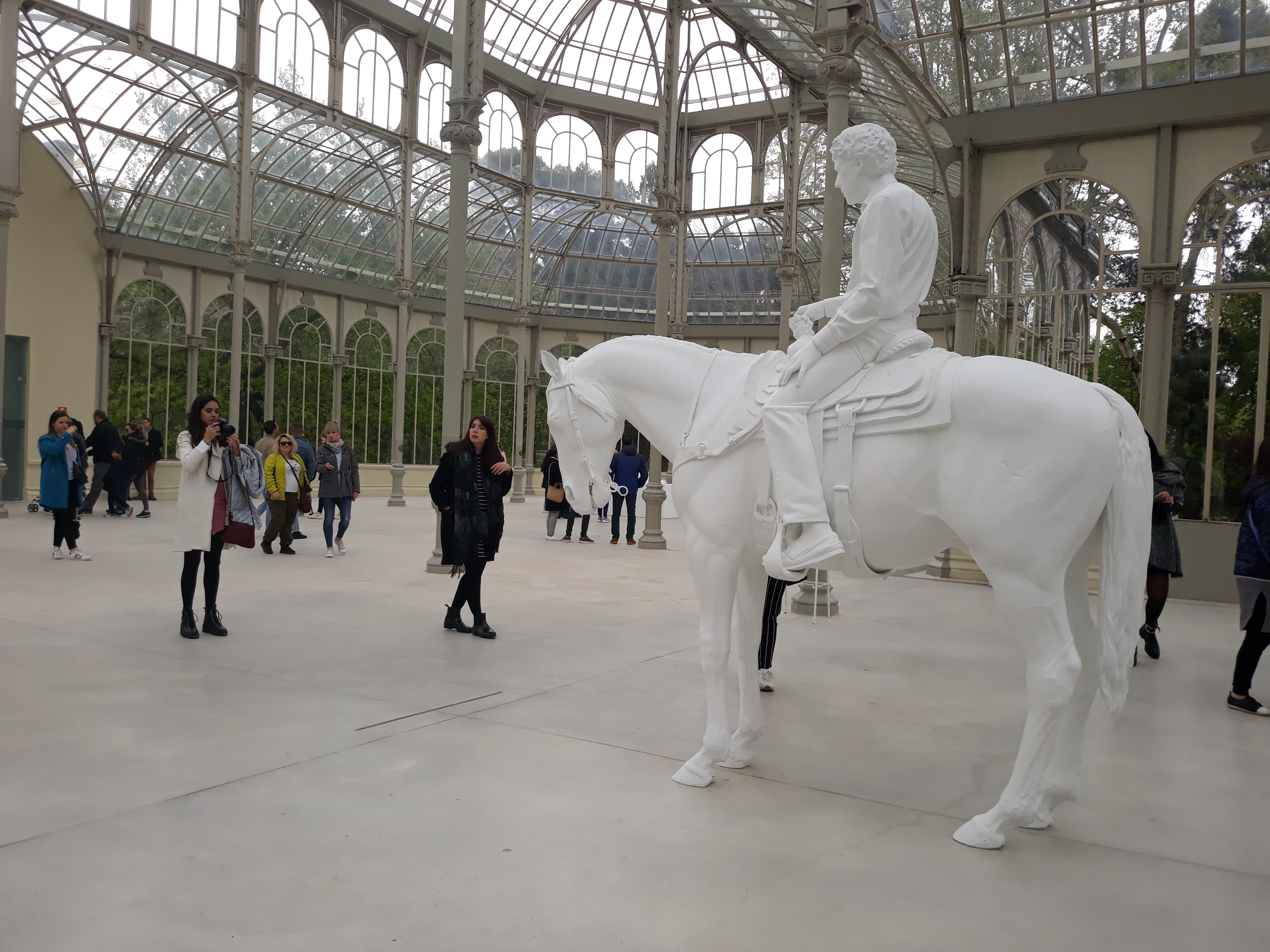 White sculpture of horse and man sitting on it