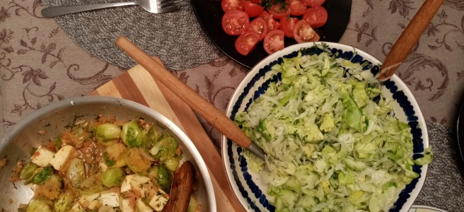 second meal in a pan and salads, top view